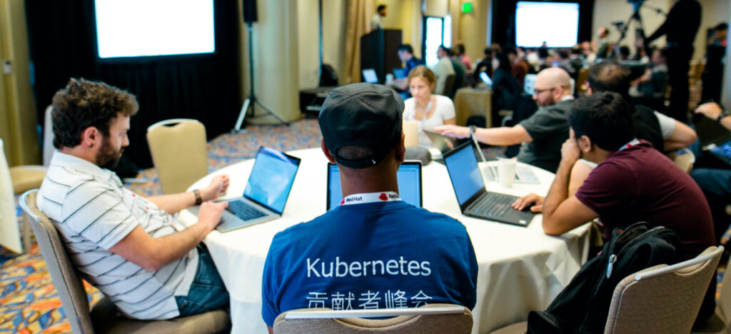 Developers with laptops attending a conference